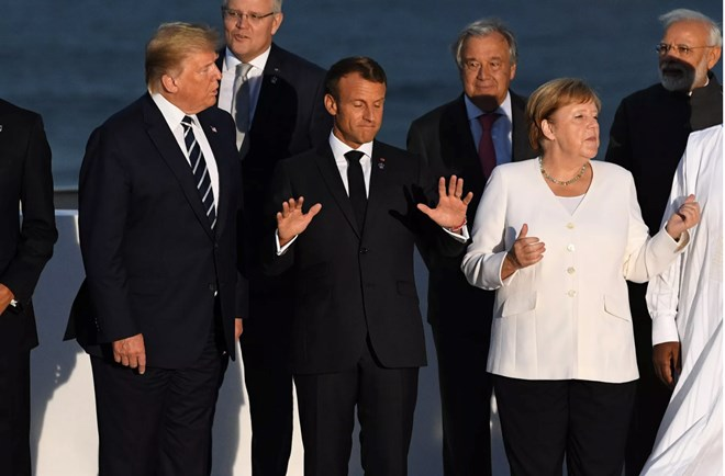 US President Donald Trump, France's President Emmanuel Macron, and Germany's Chancellor Angela Merkel join G7 leaders for a picture at the meeting on August 25, 2019 in Biarritz, France. Photo by Andrew Parsons - Pool/Getty Images