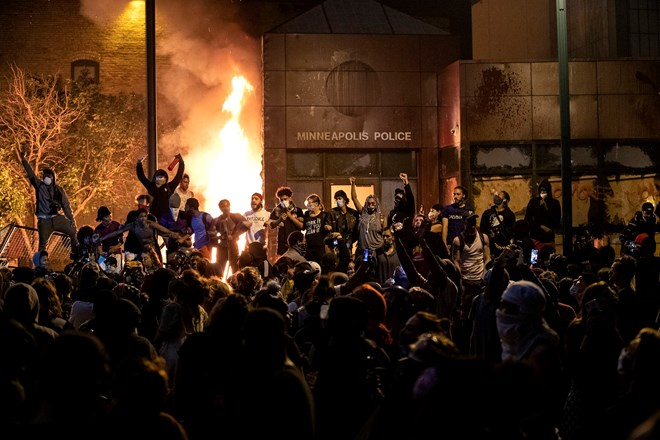 The Minneapolis Third Police Precinct is set on fire on May 28, 2020 during a third night of protests following the death of George Floyd.Carlos Gonzalez / Star Tribune via Getty Images