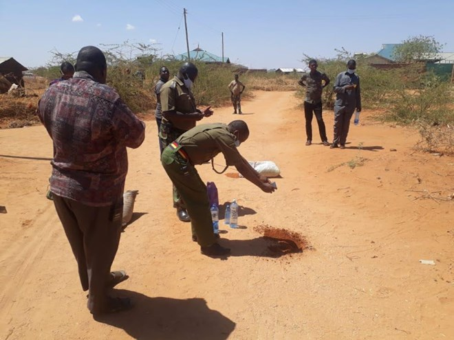 Police at the scene where three al Shabaab militants died following an explosion of their own IED device in Fafi, Garissa county on Thursday evening.
