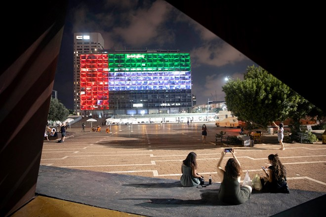 The flag of the United Arab Emirates projected on city hall in Tel Aviv after the announcement of the establishment of diplomatic ties between Israel and the U.A.E.Credit...Oded Balilty/Associated Press