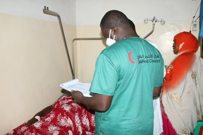 A beneficiary receives treatment under QRCS's surgery campaign in Somalia.