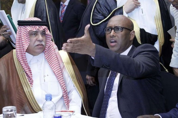 Kenya's Industry, Trade and Cooperatives Cabinet Secretary Adan Mohammed (center), flanked by Saudi Arabia's Minister of Commerce and Investment Majed Bin Abdullah Al Kassabi (left), speaks at a forum at Villa Rosa Kempinski Hotel in Nairobi on April 12, 2017. Resolutions seen by the Sunday Nation show that Saudi Arabia and Kenya agreed to work together on a number of issues. PHOTO | DIANA NGILA | NATION MEDIA GROUP.