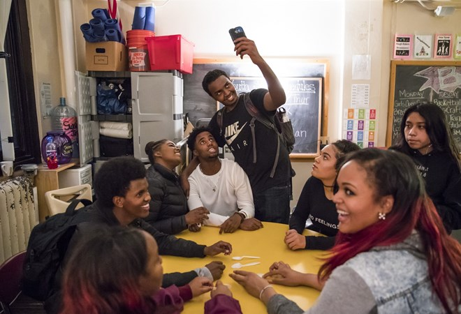 Mohamed Hassan took a selfie with friends at an after school hang-out at Roosevelt High School in Minneapolis, Minn., on December 2, 2016. Renee Jones Schneider
