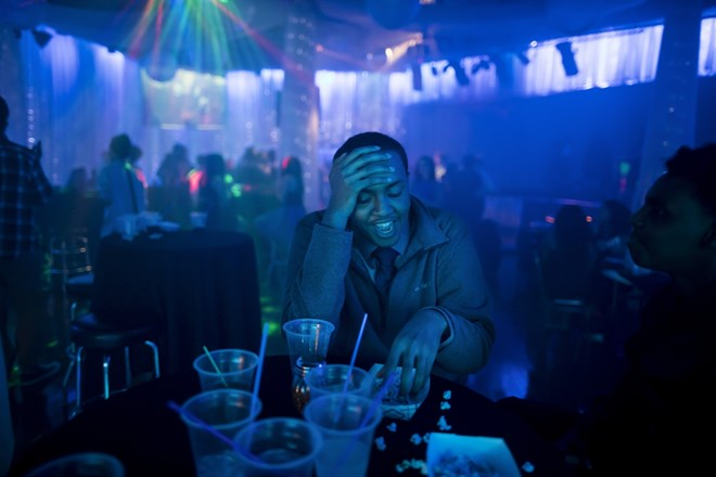 Mohamed Hassan laughed as he drank soda and hung out with friends at a table at a Roosevelt High School school dance on February 16, 2017 in Minneapolis, Minn. Renee Jones Schneider