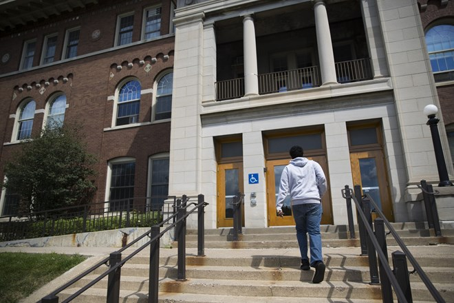 Mohamed Hassan walked into the building that houses many of his future college class at the University of Minnesota on August 8, 2017 in St. Paul, Minn. Renee Jones Schneider