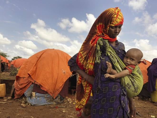 Kaltun Aliyow Mumin, 28, with her daughter Sahra Haret is two years old. They are living in Dusta Camp in Baidoa, they moved here when their savings ran out and their goats died. Their goats were the main source of income. They want to return to their lan