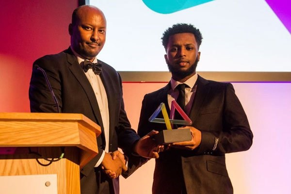 Chelsea academy player Mukhtar Ali receives an award as Somali Sportsman of the Year from Dahabshiil Chief Executive Officer Abdirashid Duale in London on March 16, 2017. PHOTO | COURTESY