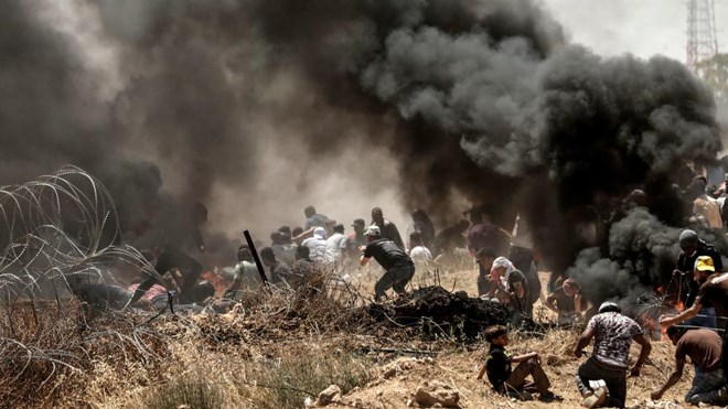 Palestinians clash with Israeli forces near the border between the Gaza strip and Israel east of Gaza City on May 14, 2018, as Palestinians protest over the inauguration of the US embassy following its controversial move to Jerusalem.