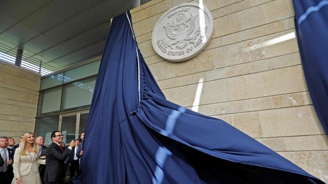 Menahem Kahana / AFP/Getty Images - US Treasury Secretary Steve Mnuchin and Senior Advisor to the President Ivanka Trump unveil an inauguration plaque during the opening of the US embassy in Jerusalem on May 14, 2018. The United States moved its embassy in Israel to Jerusalem after months of global outcry, Palestinian anger and exuberant praise from Israelis over President Donald Trump's decision tossing aside decades of precedent.