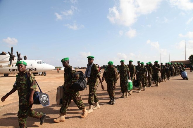 KDF troops get ready to board a plane as their rotation in Kismayo, Somalia. The troops have served in the southern city of Kismayo for over years now, as part of the African Union Mission in Somalia. AMISOM Photo/ Awil Abukar